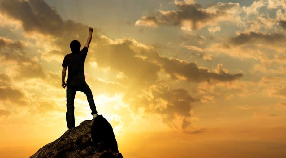 Man on the peak of mountain and sunlight , success,winner, leade