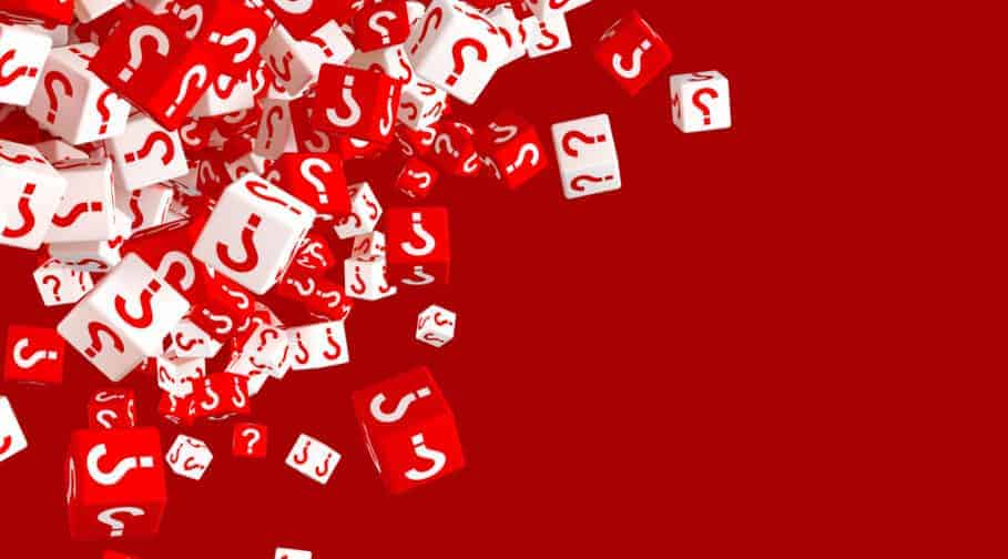 Lots of falling red and white dice with question marks on the si